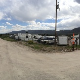 View of dirt road (and tiny gate) to RV Storage lot, The Odssey's temporary home