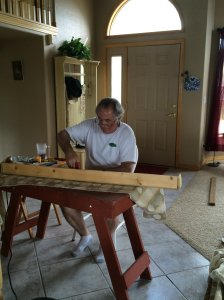 Brian Stapling New Fabric onto Window Valances